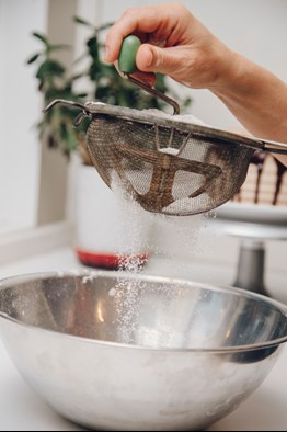 sifting baking soda into a bowl in Ann Arbor MI